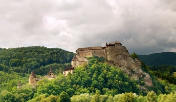 A view of famous Orava Castle in summer. Orava Castle is considered to be one of the most interesting castles in Slovakia. This castle is situated on a high rock above the river Orava. It is located in Oravsky Podzamok town, Slovakia.