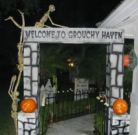 DIY Halloween Graveyard Entrance made with styrofoam, cardboard, and paint.
