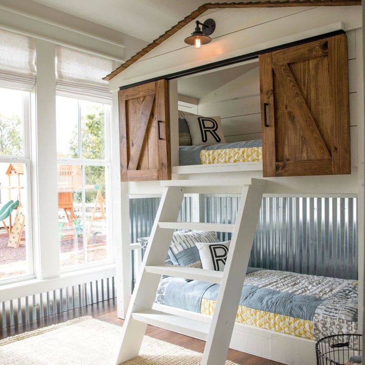 This custom-built bunk bed for the Matsumoto house was such a fun project! Bunk beds turned playhouse with sliding barn doors—now that can't be beat! #FixerUpper