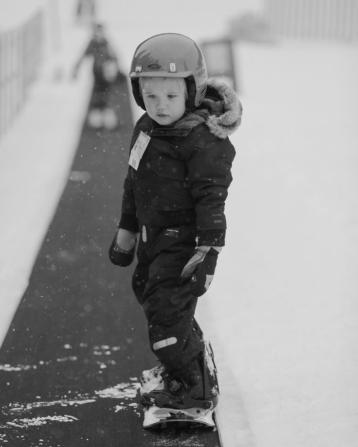 """This is not the face of a boy who doesn't want to snowboard, this is the face of a boy who wants to ride the """"big kid lift"""" but has to pay his dues in on the magic carpet."""