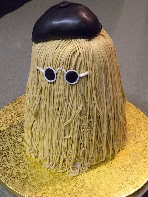 Cousin It Cake - ha ha!  =)  I used to put sunglasses on the back of my head when I had long (straighter) hair!  =)