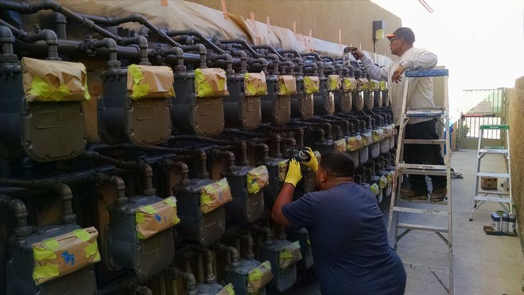 ProTec Building Services painting techs maintaining H.O. gas meters. How are your gas meters looking?
