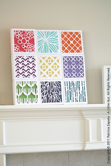 These are gift boxes that have been cut out with a contrasting color behind the white.