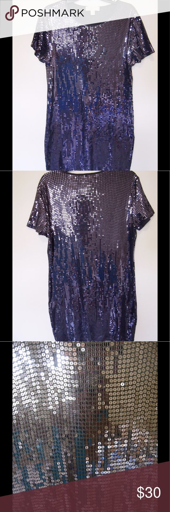 Michael Michael Kors Grey Sequin Dress Size XL This is a grey dress although it picks up a bit blue in the picture. Never the less this dress is in excellent condition. This dress has no flaws, all of the sequin are in tack. This dress comes slightly above the knee on most individuals and is 100% cotton. Please feel free to ask any questions regarding this beauty before purchasing. Thanks MICHAEL Michael Kors Dresses Midi