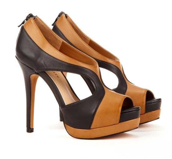 Two tone colour & rhythm of design shapes the shoe - classy