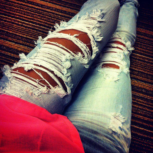 Cute ripped light wash denim jeans. Great in the summer with neon top to show off that tan!