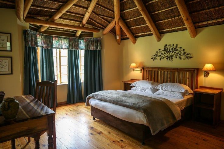 Bedroom at Coral Tree Cottages near Plettenberg Bay