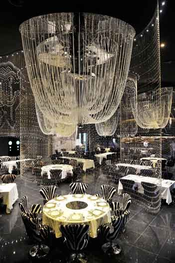 Cavalli Club – Location: Fairmont Hotel on Sheikh Zayed Road; Setting: Designed by Roberto Cavalli, the restaurant is set over 3 levels with chandeliers and waterfalls; Type of Cuisine: Gourmet Italian and International food.