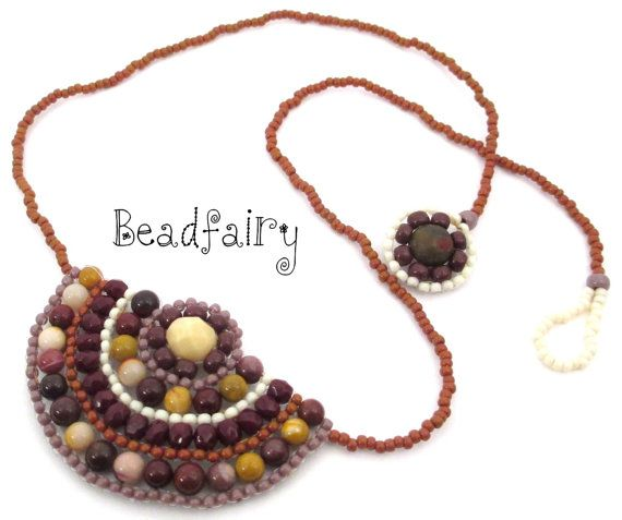 Handmade beaded neckalce shaped like a convex semicircle was created Beadfairy original design to highlight the tribal, boheminan , ethnic and hippie style. It is made of natural materials (semiprecious stones) whose texture highlights the beauty of the necklace makes it unique and special. The time required for manufacturing the set was approximately 1.30 hours of work. The necklace is made to be worn on base of the neck, it is lightweight, flat, flawless, with identical design on both…