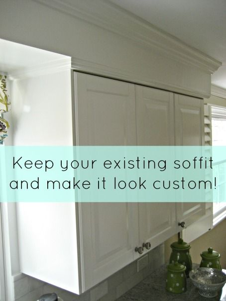 Use crown molding and cabinet trim to make soffit look custom. Cabinets are Ikea Lidingo.