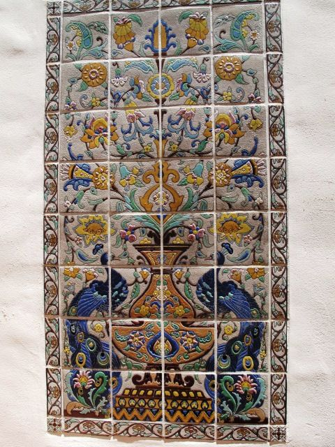 A 32-tile peacock Saracen panel, made with the cuerda seca technique, in a courtyard at the Adamson House