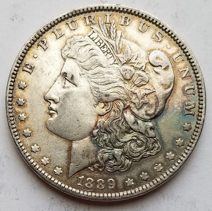 Morgan with a little color for sale, follow the link to buy or to look at my other coins for sale