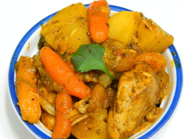 Pollo Guisado Estilo Puertorriqueño (Stewed Chicken Puerto Rican Style) Recipe Main Dishes with chicken breasts, chicken pieces, adobo, garlic powder, cumin, oregano, canola oil, sofrito, tomato sauce, olives, cilantro, sazon, water, carrots, potatoes, salt