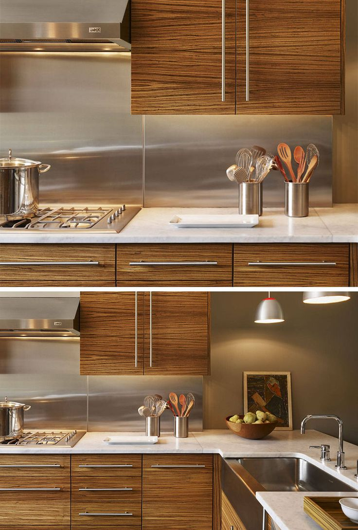 Kitchen Design Idea - Install A Stainless Steel Backsplash For A Sleek Look | All of the stainless steel details like the sink, hardware, and utensil holders, work with the stainless steel backsplash and make this kitchen cohesive and put together.