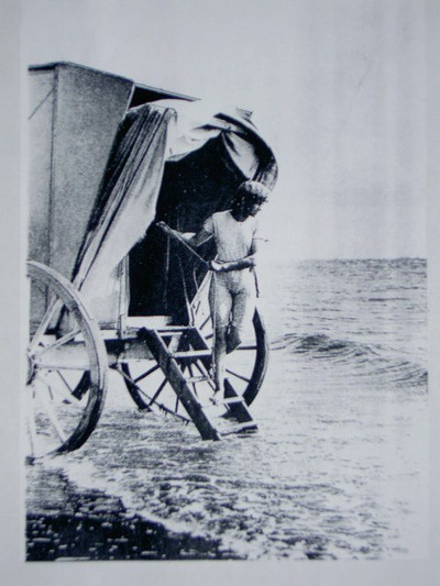 a man in a swimsuit gets out of a bathing machine, 1891.
