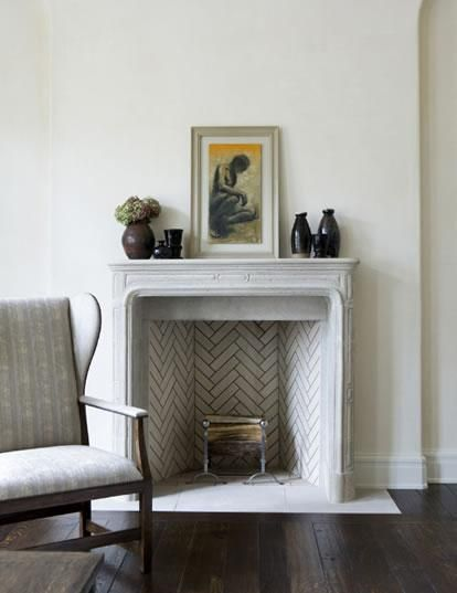 herringbone detail in fireplace; you can try this pattern vertically or horizontally with any of our materials: Brick, Glass or Tile.