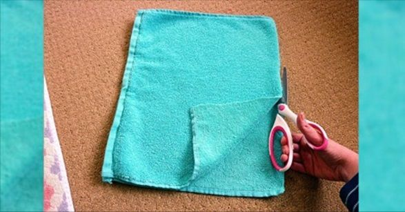 Upcycled towel into bath mat.