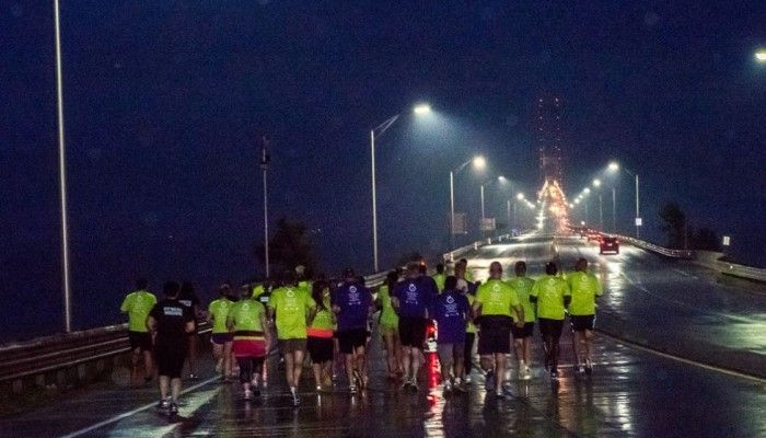 Michigan National Guard Soldiers lined the Mackinac Bridge. Sept. 7, 2015, to provide encouragement and ensure the safety of runners and walkers crossing during the annual Labor Day Bridge Run. Each State of Michigan department selected representatives to run the bridge in support of their employer. The two runners representing the Department of Military and Veterans Affairs were Noelle Rouse (Human Resources) and Angela Simpson (Public Affairs). Photo by Michigan Running Foundation.
