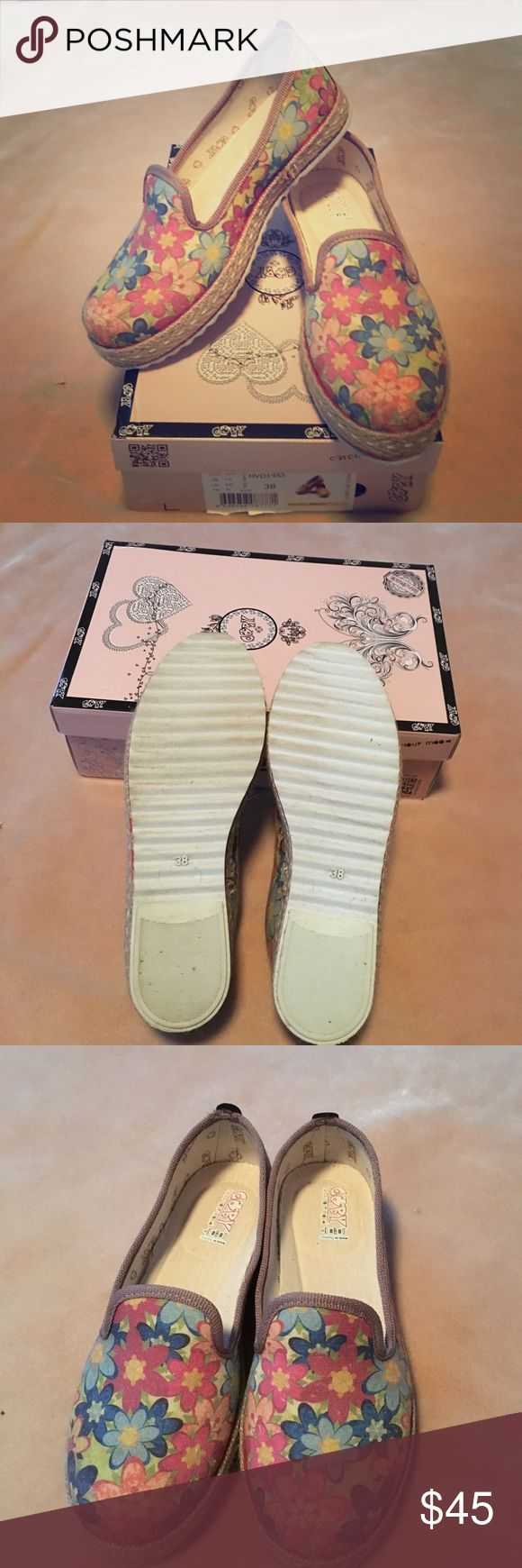 Goby canvas floral espadrilles. Size 38 These canvas espadrilles have a padded foam insole. The floral pattern is slightly muted. They were worn once inside for fit only. They are a little shorter than my other Goby size 38 shoes.  Essentially they are new in box. Goby Shoes Espadrilles