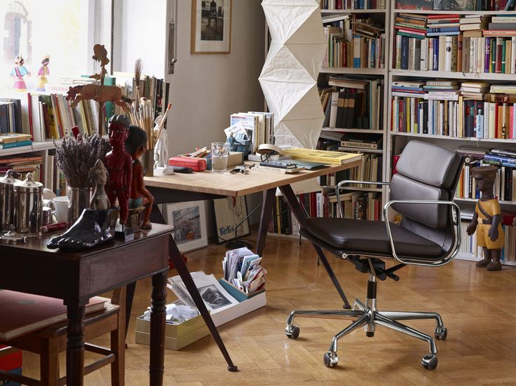 Working is better with the Soft Pad Chairs by Charles and Ray Eames.