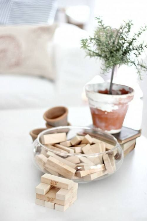 leave jenga pieces out on coffee table   (Magnolia Homes)