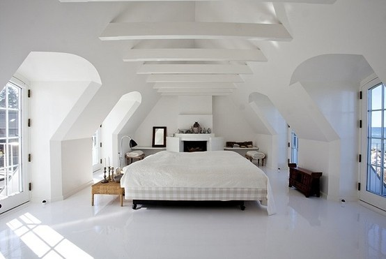 Bright bedroom in whites with sea view. White raisin flooring and beautiful natural light from the windows. Scandinavian.
