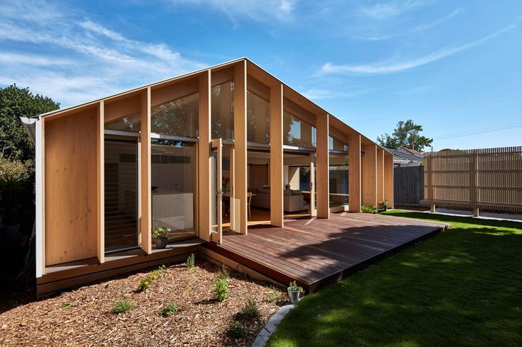 Timber fins shade glazed gable added to Melbourne home by Warc Studio