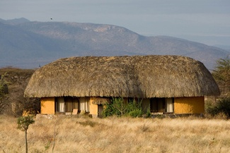 Samburu Sopa Lodge is built overlooking the wildlife-rich banks of the Ewaso Nyiro river, and is comprised of 60 en-suite rooms, all with balconies from which to view the hills, plains and river surrounding the lodge.