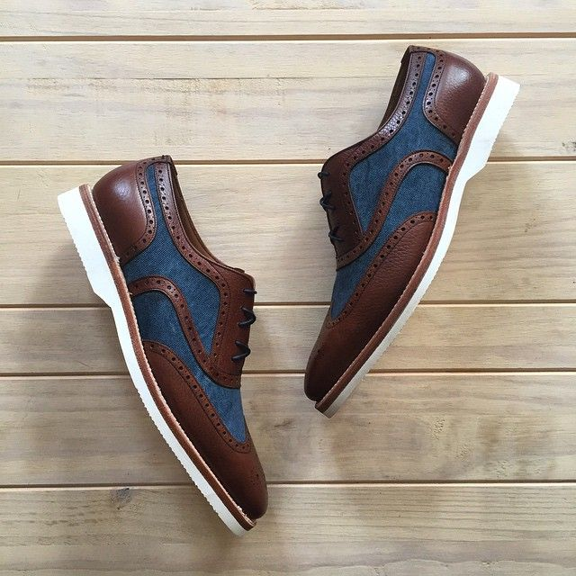 New Spectators crafted on brown scotch grain leather & navy blue fabric. Manufactured on extra light rubber sole. Email us to order: sales@andres-sendra.com