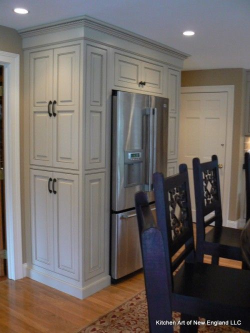 Build a cabinetry wall around a freestanding refrigerator. Design the  cabinetry with multiple depths to create impact and the look of a built-in  ...