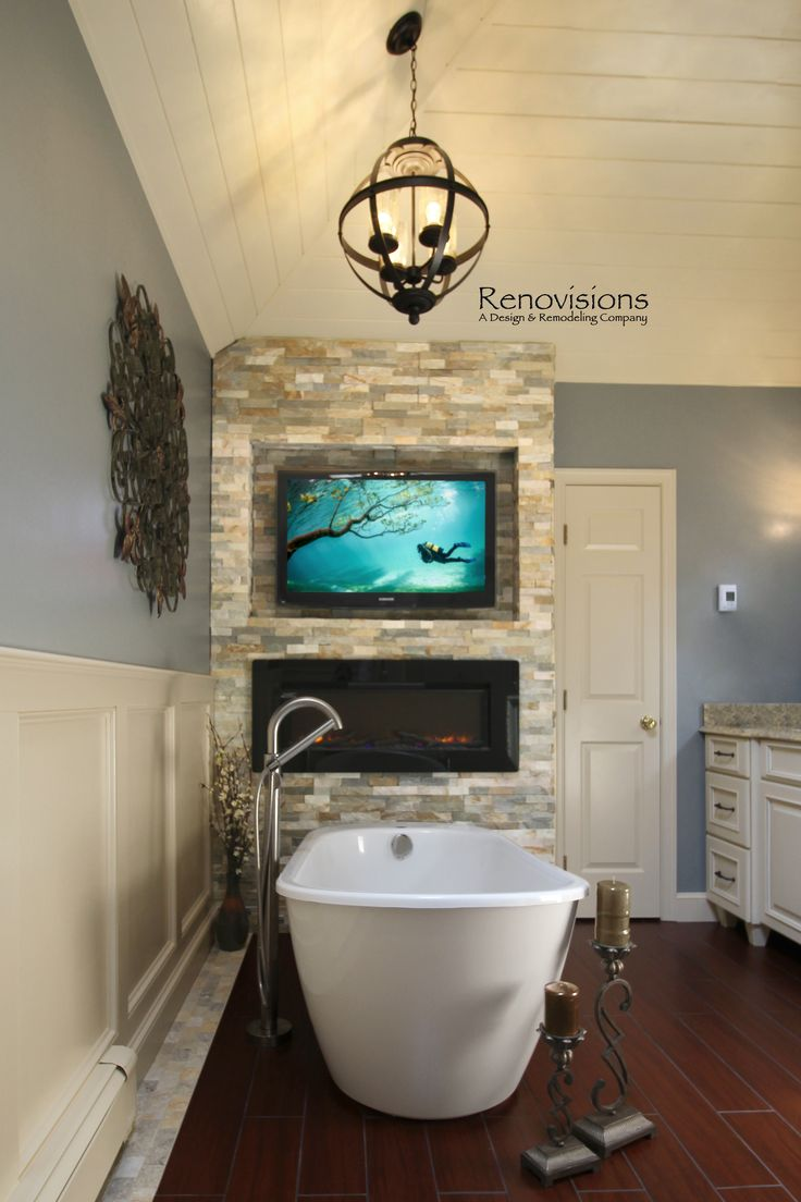 A recently completed master bathroom remodel by Renovisions. I like everything except the television!