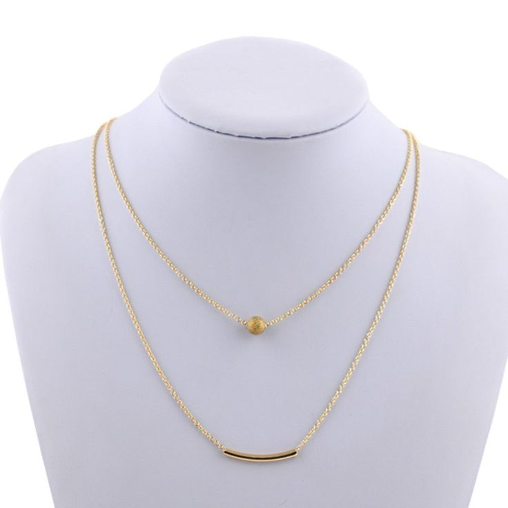 "Cate and Chloe Brianna ""Strong"" Double Strand Necklace. ""Gold plated layered necklace Lobster clasp Short chain = 18"""", Long chain = 20"""", Necklace extender = 3"""" Ball dimensions = 0.5"""" x 0.5"""" Bar dimensions = 1.3"""" x 0.25""""""."