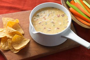 Famous Queso Dip recipe-Hot, cheesy and sooo easy, this dip  is ready for its close-up at your  game-day party. #GameDay