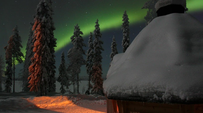 Northern Lights over a Kota in Ruka, Finnish Lapland