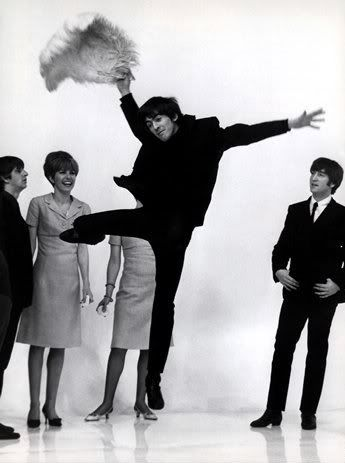 George Harrison kicks up his Beatle boots.