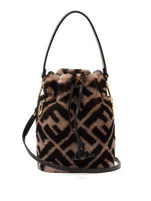 Mon Tresor Logo Print Shearling Bucket Bag Fendi Matchesfashion Com Uk