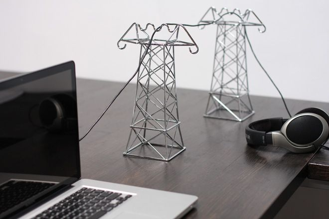 Miniaturized  power lines strung in bent, chromed wire - works well for the desk