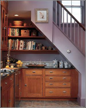 This under the stairway kitchenette is a very creative use of space!