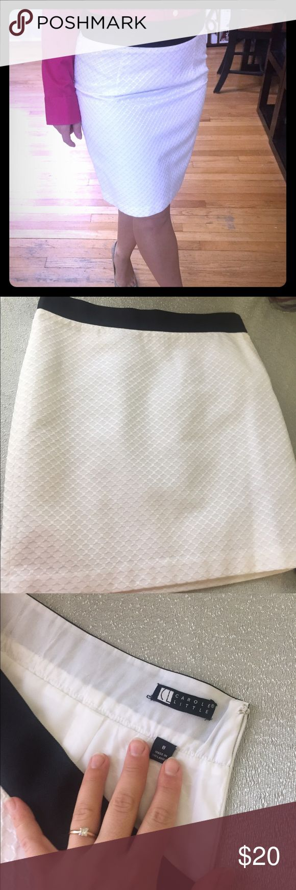 White textured mid skirt w/ black waist trim Textured white skirt, double layer with zipper on the side, size 8, gently used great condition, black waist trim, knee length, can be worn for business or casual. Carole Little Skirts Midi