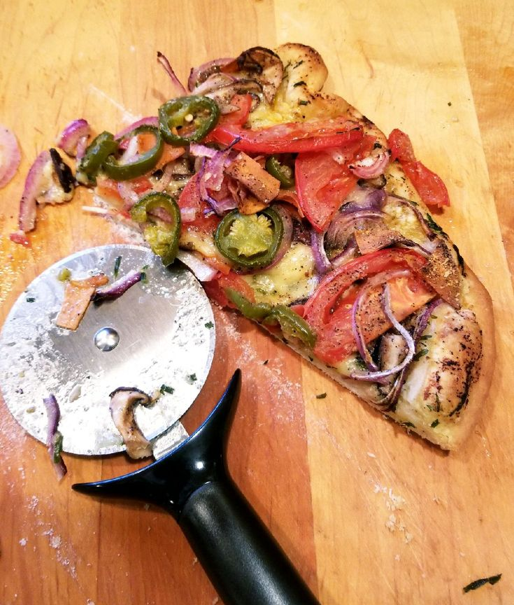 My Vegan Pizza baked on a 'baking stone' vegan garlic tarragon butter spread onion shiitake mushrooms follow your heart smoked Gouda tomatoes and picked jalapenos