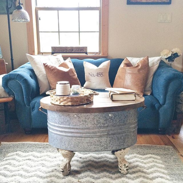 I get tons of questions about our coffee table, so I thought I would share a little bit about it! I bought a set of old cast iron claw feet (easy to find on eBay) and a galvanized tub (this one is from @potterybarn because I didn't have the patience to wait and find a vintage one in the right size!). I gave everything to my hubby, explained my idea and wished him luck He added the wood top, which hinges and holds lots of Sadie's games and puzzles because, when you have a small house, yo...