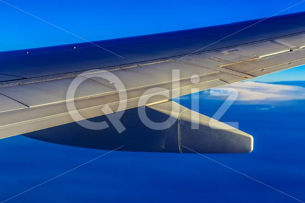 Qdiz Stock Images Plane Wing above Sky and Clouds