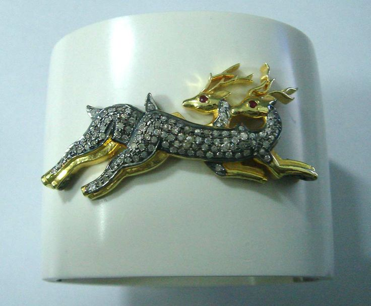 Ceramic cuff bracelet with beautiful gold plated silver deer design. The hand made deer are studded with high quality cubic zirconia crystals.