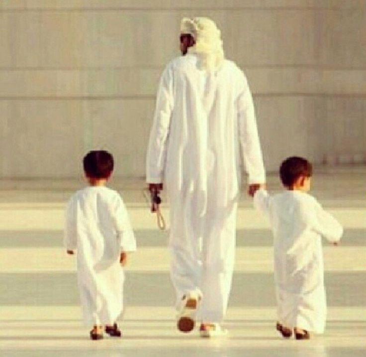 Aww... Leaving the Masjid with Daddy after Salah!