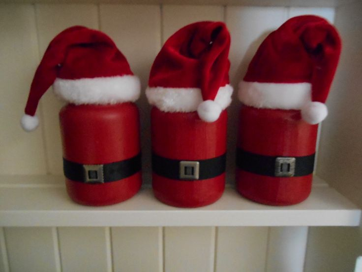 upcycled large Yankee Candle jars with Yankee Santa hats