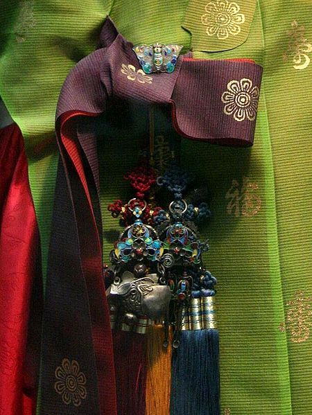 Norigae (hangul: 노리개) is a typical traditional accessory that is hung from a woman's jeogori goreum (coat strings) or hanbok chima (skirt) and so on.