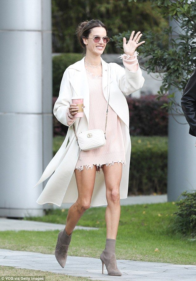 Showcasing her best assets: Alessandra looked elegant in the baby pink jumper-style frock which featured a frayed edge to draw further attention to her lengthy limbs