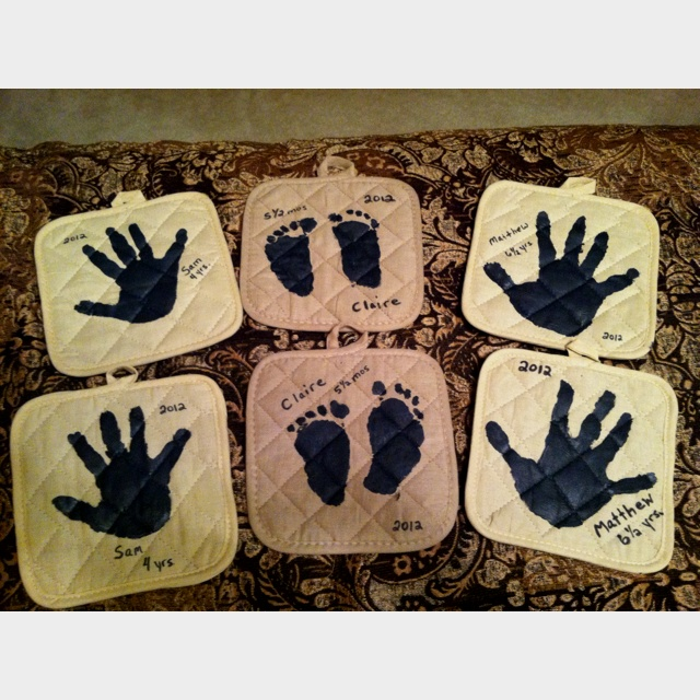 Handprint Potholders!  Made for Mother's Day.  Potholders from Dollar Tree (2 for $1.00) and black matte fabric paint made by Tulip.  Easy!