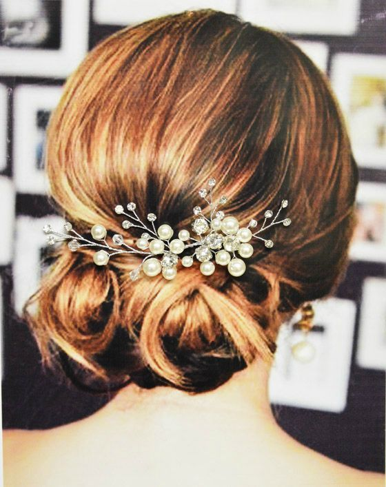 This exquisite Paris bridal hair comb is made with beautiful white acrylic…