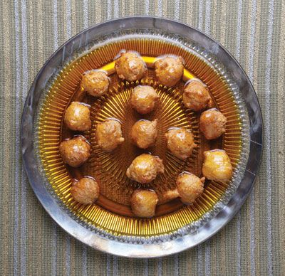 These fluffy fritters, soaked in a syrup flavored with saffron, cardamom, and cinnamon, are a favorite Emirati dessert during Ramadan.